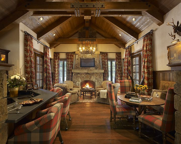 Nestled in the pines this mountain retreat evokes the for Hunting lodge designs