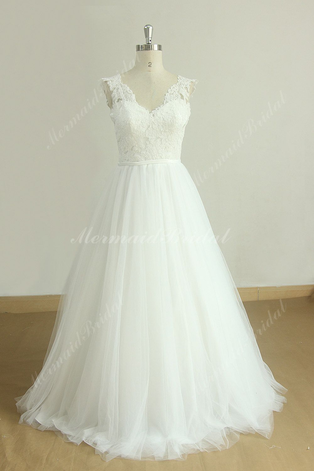 High quality flowy vintage tulle lace wedding dress with deep v