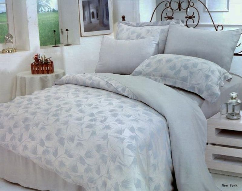 this magnificent duvet bedding set has a backdrop with aliceblue weaving of abstract feather patterns that creates the most elegant