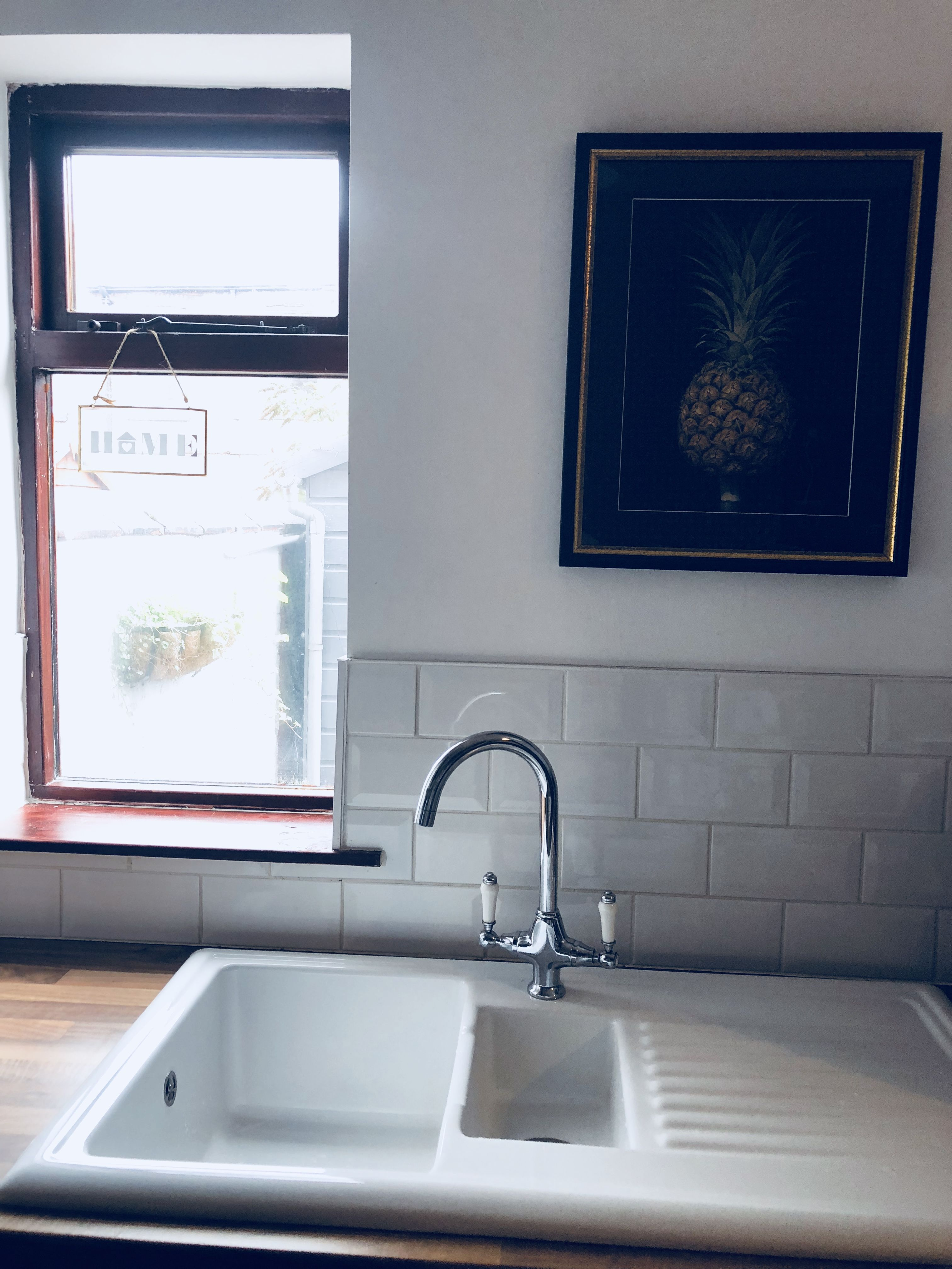 We went for a white gloss handleless kitchen. The ceramic sink is ...