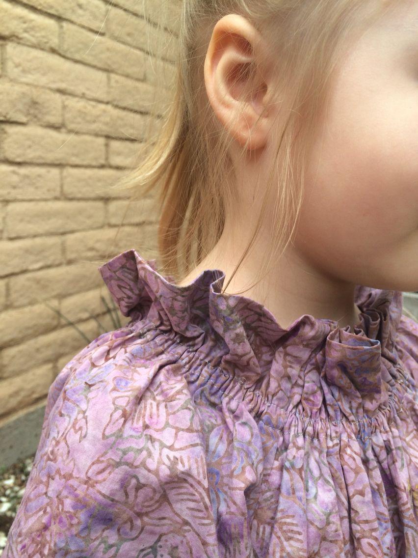 Girl's ruffley neck peasant dress