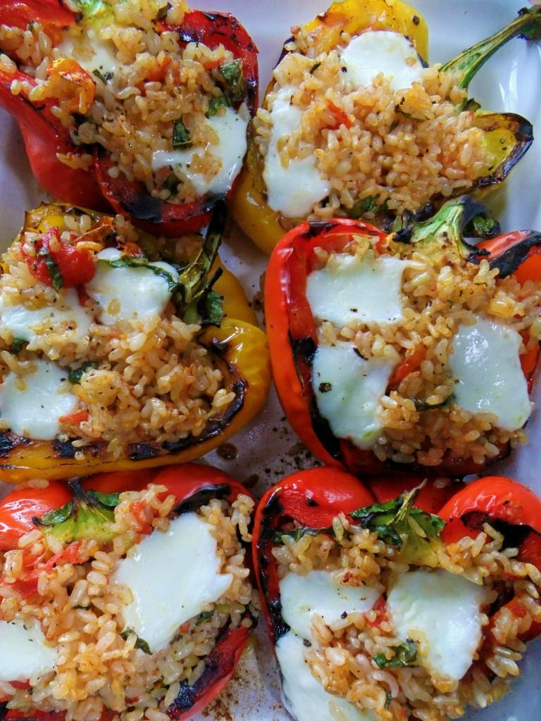 Stuffed Grilled Peppers With Brown Rice, Garlic, Onion, Grated Romano Cheese, Basil, Roasted Grape Tomatoes & Topped With Fresh Mozzarella.