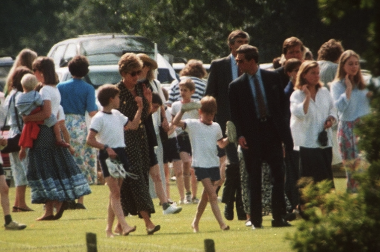 June 21, 1993: Prince Harry and Prince William greet their parents who attended their sports day at Ludgrove.(x)
