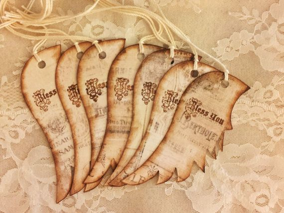 This listing is for 8 tattered-distressed angel wing gift tags. Tags measure approx. 4 x 1 3/4 and are made of doubled cardstock. Back of tags