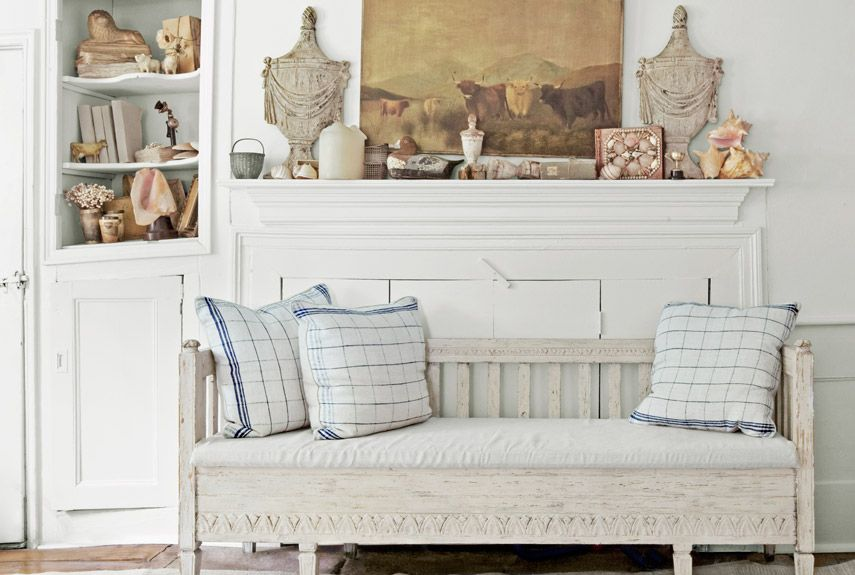 Beautiful aged white settle and vintage look cushions...