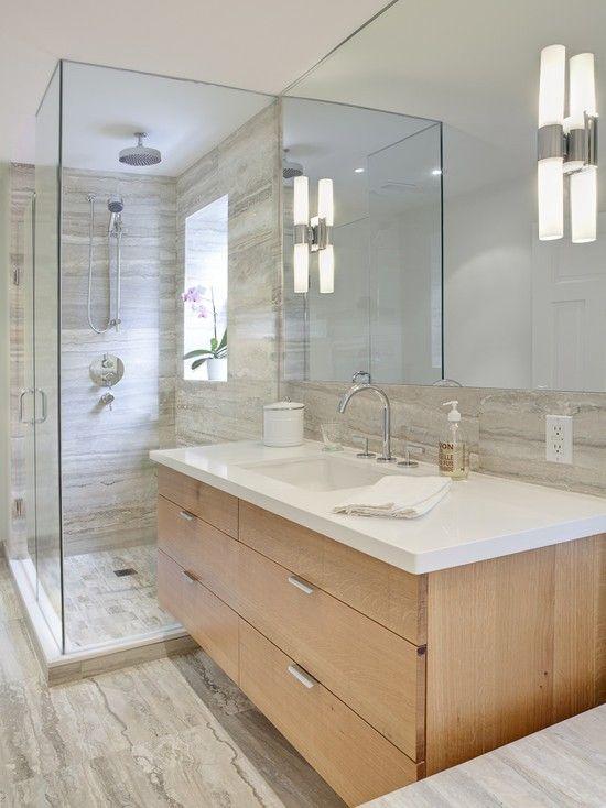 vanity abutting shower enclosure