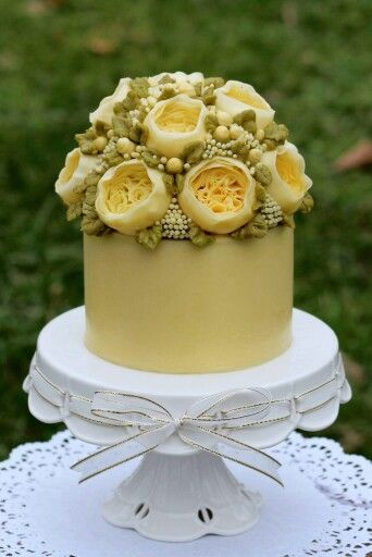 buttercream cake with floral arrangement