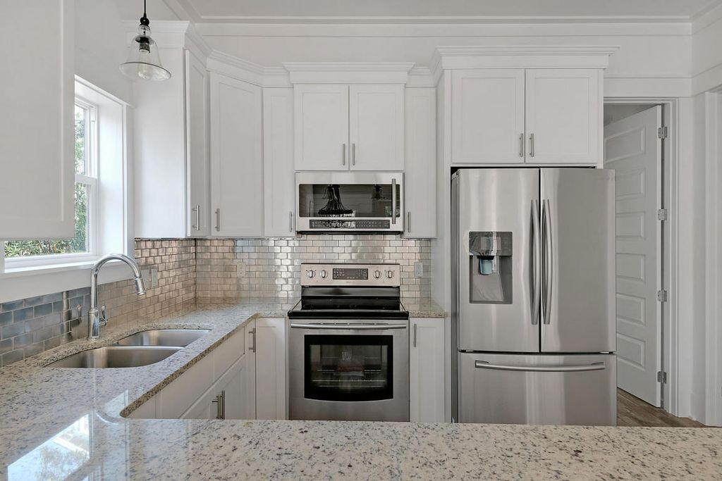 "Traditional Kitchen with Quartz Countertop in White Arabesque, U-shaped, Brick 1x2"" Metal Mosaic Stainless Steel Tile, Flush"