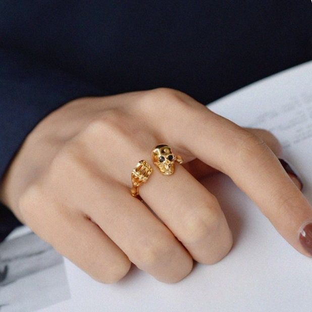 """""""🌸 Material: brass, 18k gold plated ❤️ Use code \""""THREE20\"""" to get 20% OFF when you purchase 3 or more items!! Gold Skull Ring Punk Ring Gothic Ring Adjustable Ring Open Ring Stacking Rings Unisex Ring Gold Ring Skull Engagement Ring Gothic Skull Ring * Do you love this item and want to buy it later? Just click on the heart-shape icon to your right to add it to your favourites. * About * How * To * Care * In order to extend the lifespan of your jewelry, i recommend you avoid swimming and shower"""