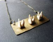 Necklace. Raccon Teeth on Brass Rectangle Finding. For Him or Her