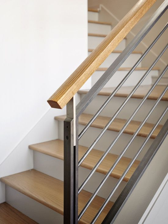 Minimalist bannister with horizontal metal bars. I like ...