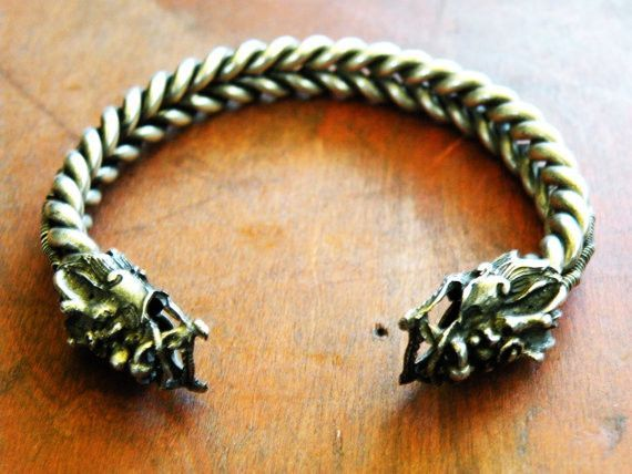 Awesome tribal bangle with two dragons, symbolizing strength and protection. Made by the Miao Hmong tribal people of the border between China and Laos. The dragon is an important symbol of strength fo