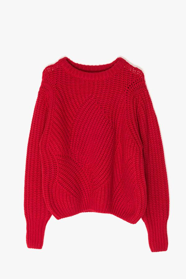 8693f4ece6 Oversized knit sweater features an enveloping fit ideal for layering ...