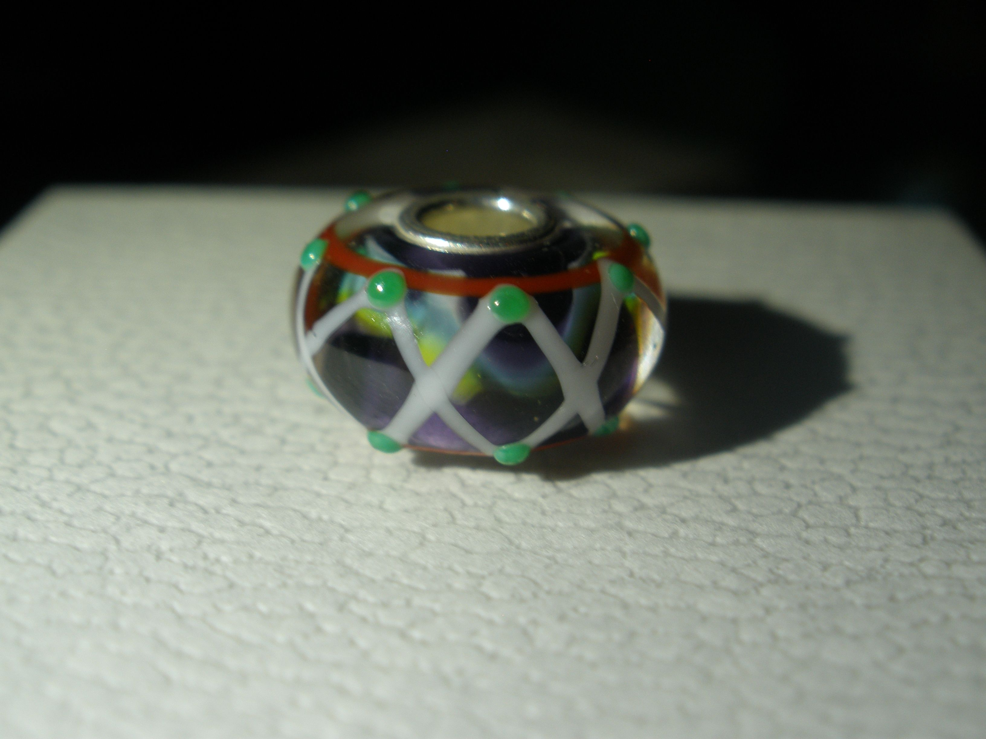 Trollbead Unique  Green dot lattice with multi-color core purchased from Trollbeads at South Park via fb April 2015