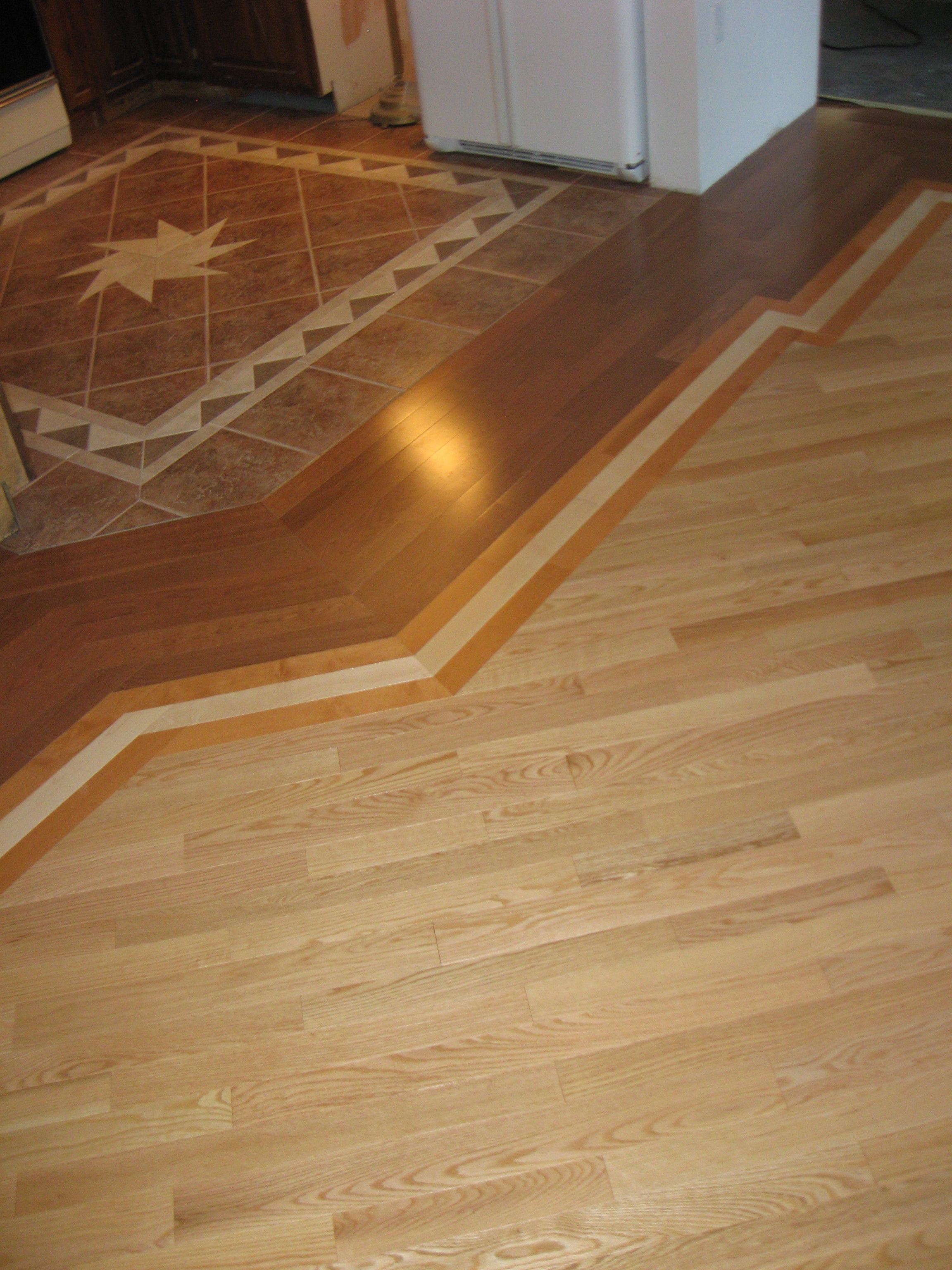 Kitchen Wood Flooring Threshold Tile To Wood Floor In Open Concept Living Room And