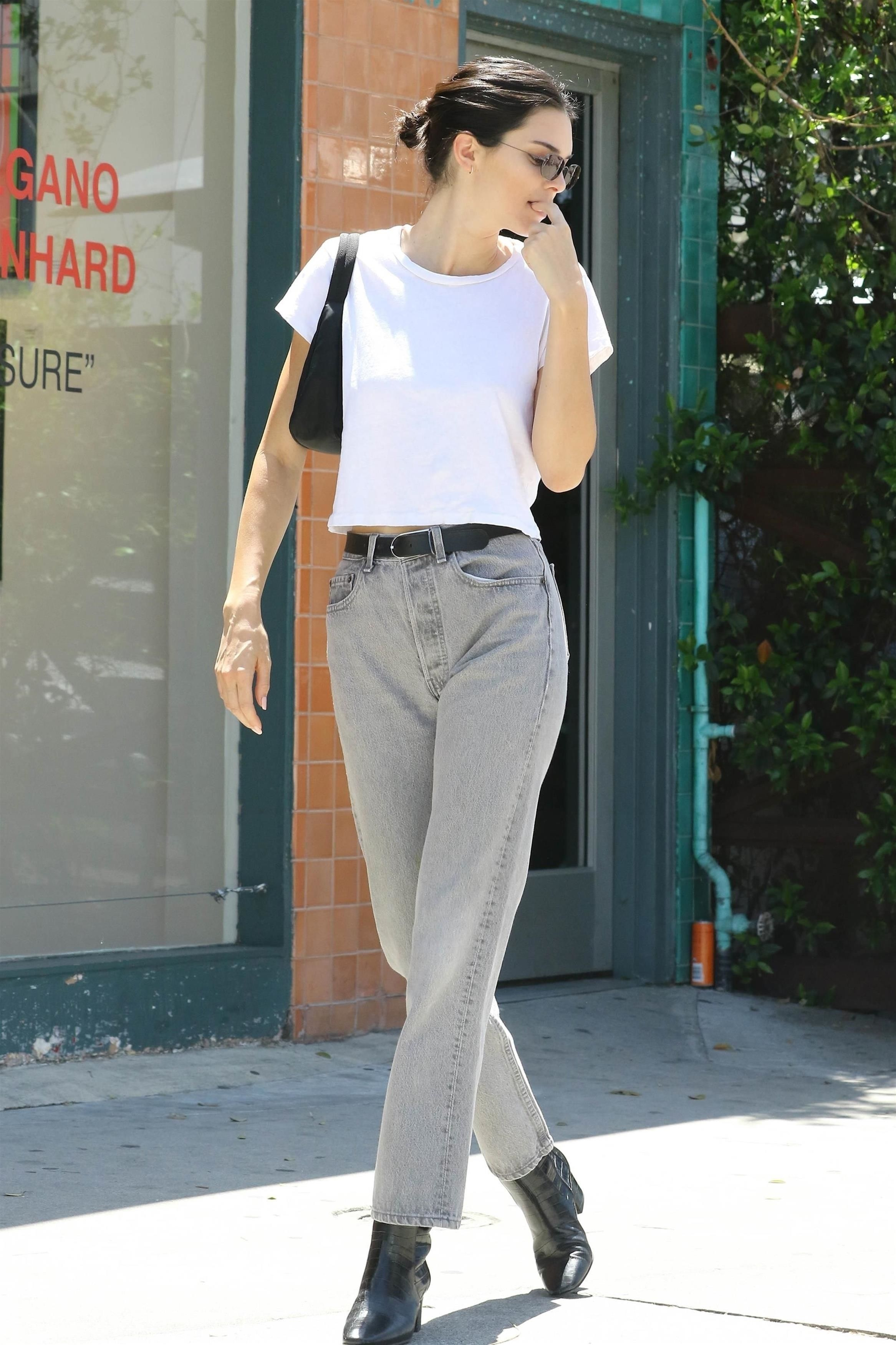 Kendall Jenner wearing Yeezy Faded Dark Jeans 986e65b0b