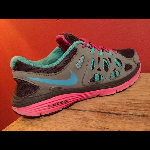 Women's Nike Dual Fusion Shoes - Size 7! Women's Nike Dual Fusion Shoes - Size 7!  Gray, Hot Pink & Teal - pre owned Good condition see pictures!! Nike Shoes Athletic Shoes