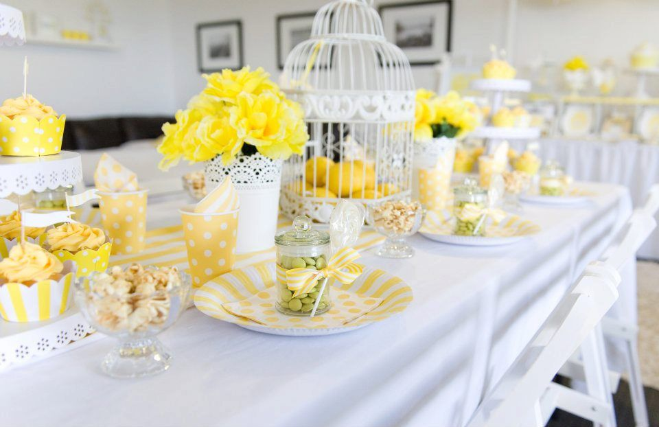 pretty yellow table decor love the candy jar favours A
