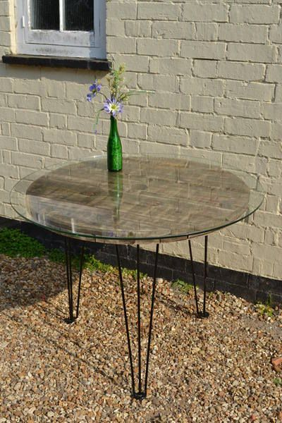 Upcycled cable reel and glass top on retro hairpin legs