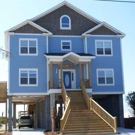 Blue Modular Home Design Feature Blue And Grey Painted Wall Together White Stained Wooden Window Frame And Wooden Outdoor Staircase Plus Space Garage Underneath a part of  under Architecture