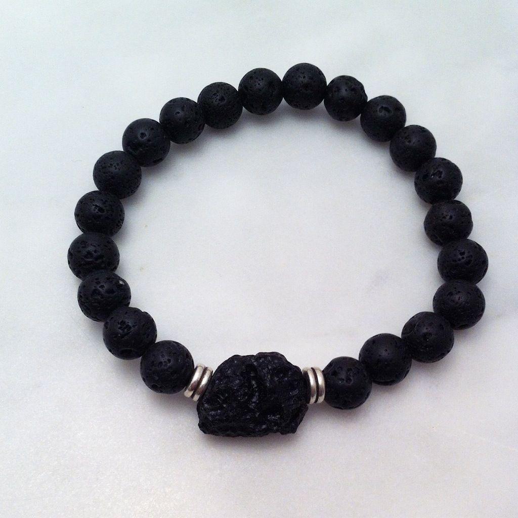 The tektite mala bracelets are made from tibetan tektite mala