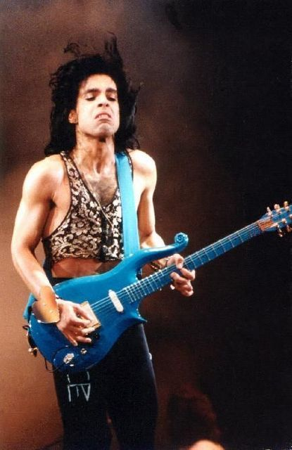 """Direct from my massive personal collection of Prince photographs! Please leave this comment attached! IN this photo from the Lovesexy era, he's playing his """"BLUE ANGEL""""  Cloud Guitar!"""