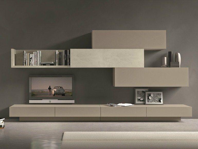 Parete attrezzata componibile fissata a muro con porta tv for Salotto con tv