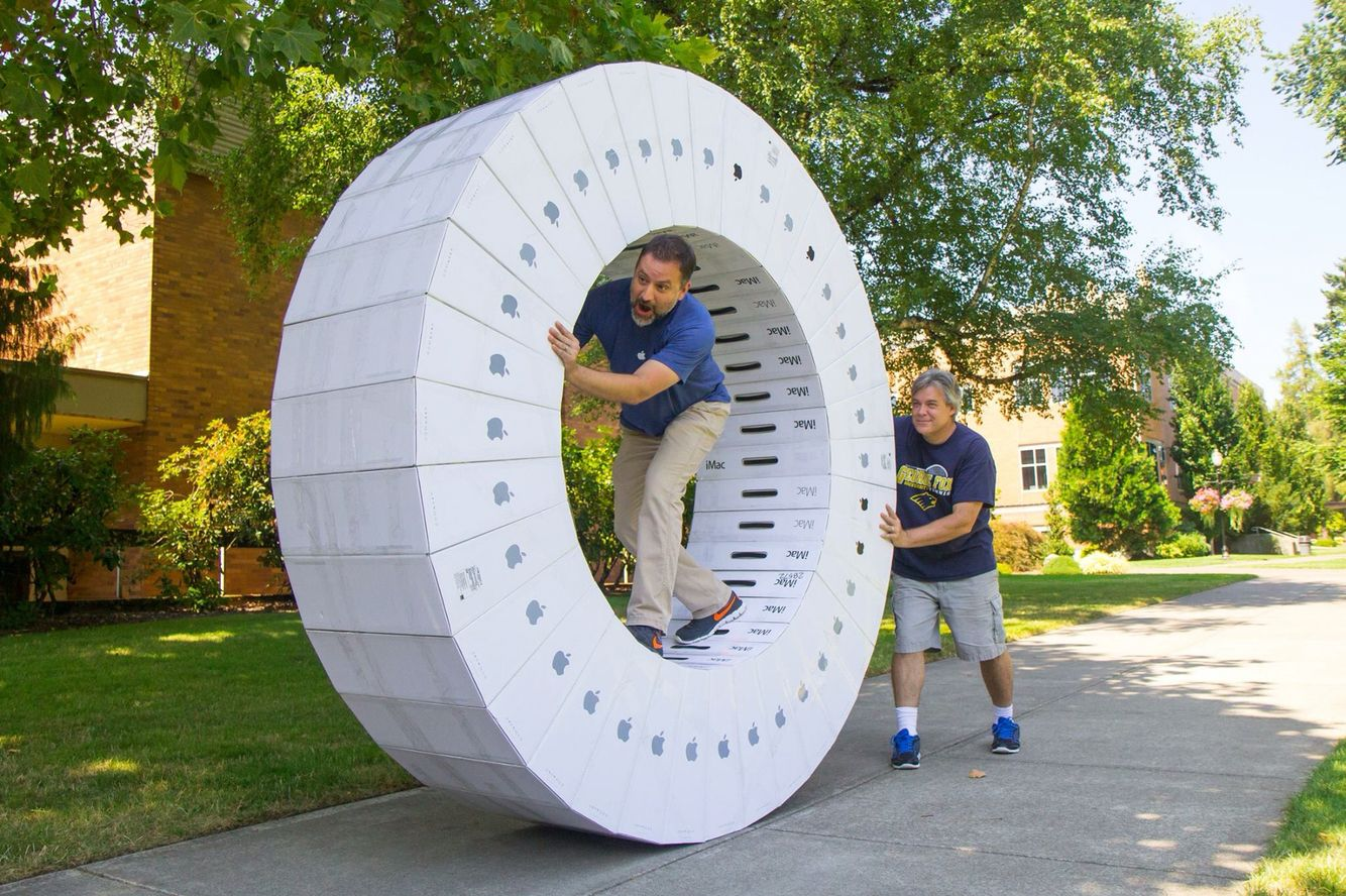 Human Hamster Wheel Made Out Of Imac Boxes School Technical Staff
