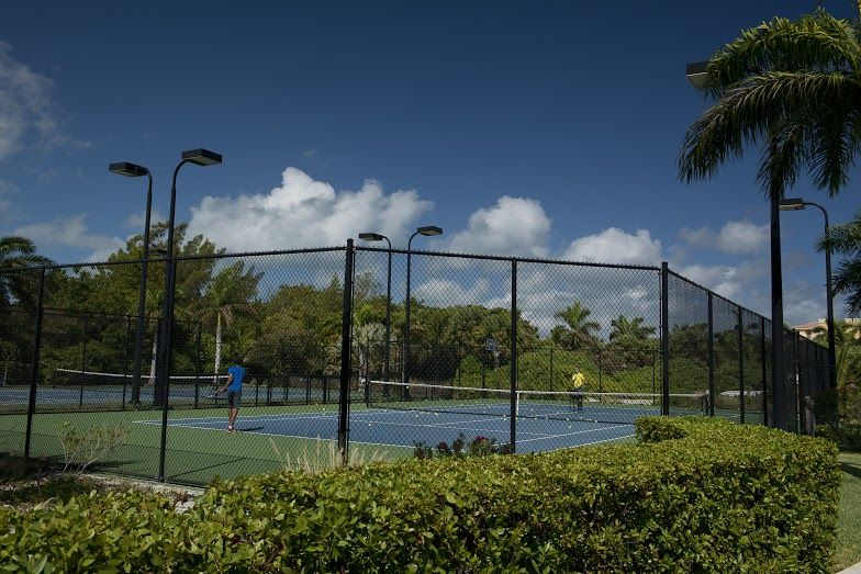 Lit tennis courts available onsite for complimentary guest use