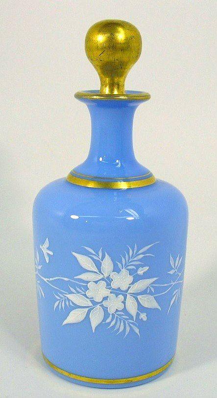Antique vintage blue opaline glass perfume scent bottles with dragonflies.