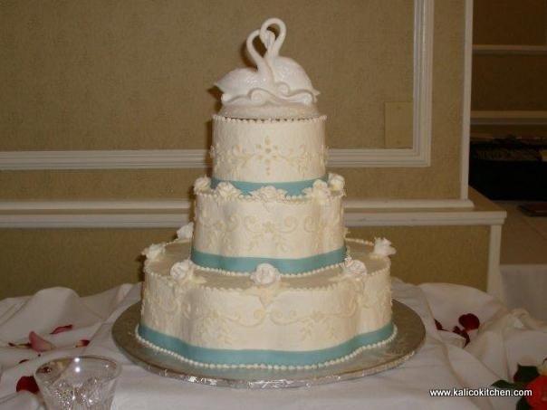 Wedding Cakes- 3 tier, buttercream, flower shaped, blue fondant ribbons, sugar roses, swans topper- 1