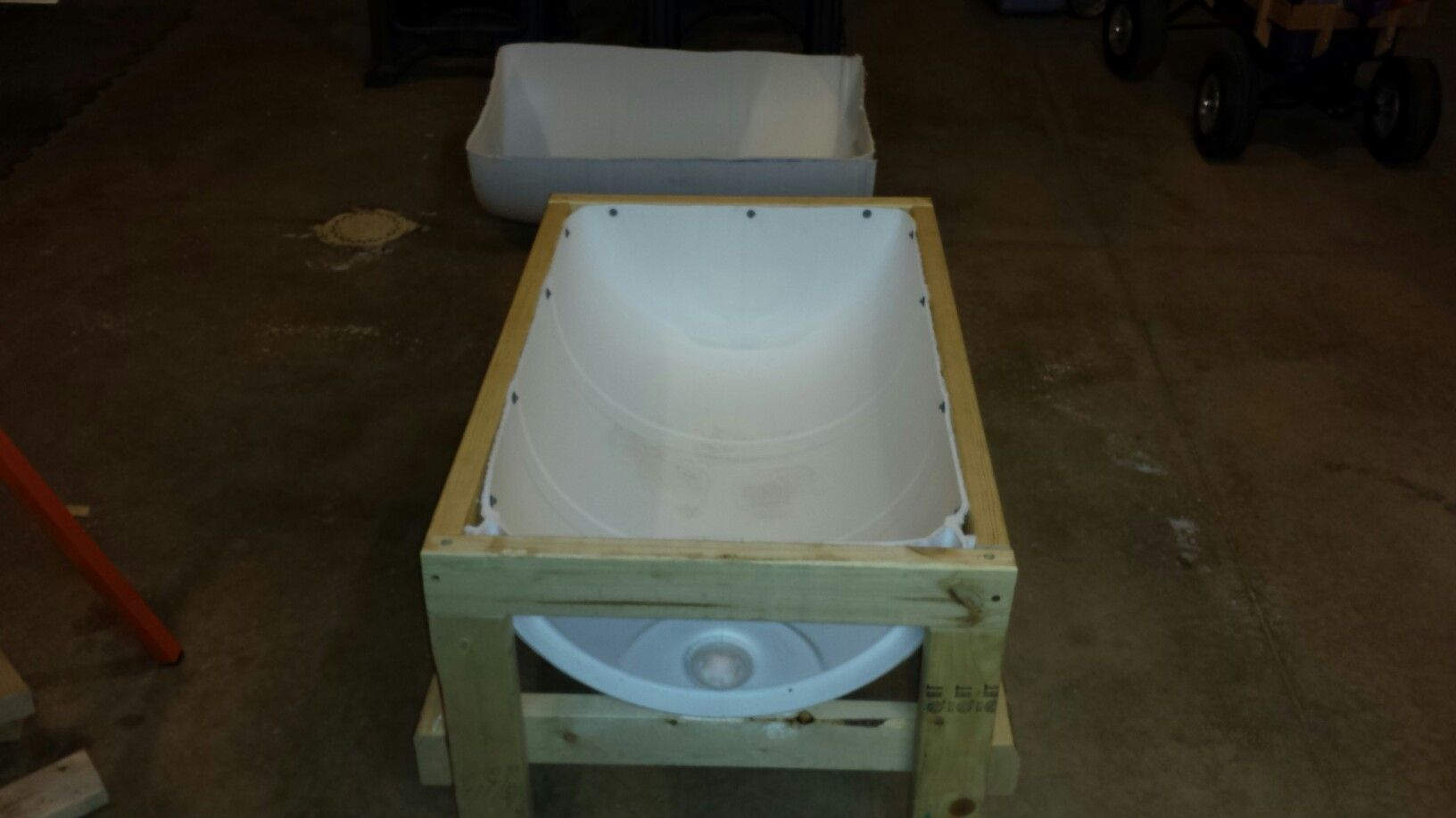Grain feeder built from a 55 gallon barrel and 2x4s | cow