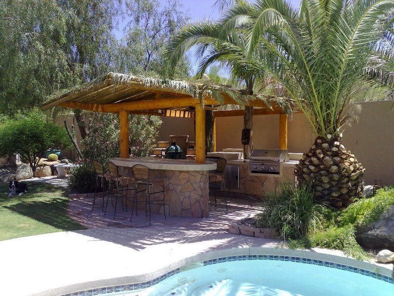 Amazing outdoor kitchens bbq island tiki bars and for Outdoor grill island ideas