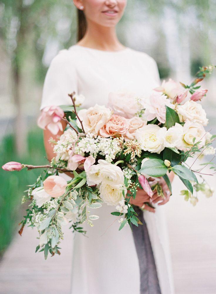 Cascading rose and ranunculus wedding bouquet: Floral Design: Bows and Arrows - http://bowsandarrowsflowers.com Venue: Nasher Sculpture Center - http://www.stylemepretty.com/portfolio/the-nasher-sculpture-center Wedding Dresses: Sarah Seven - http://www.stylemepretty.com/portfolio/sarah-seven-2   Read More on SMP: http://www.stylemepretty.com/2017/03/21/modern-art-romantic-florals-wedding-inspiration/