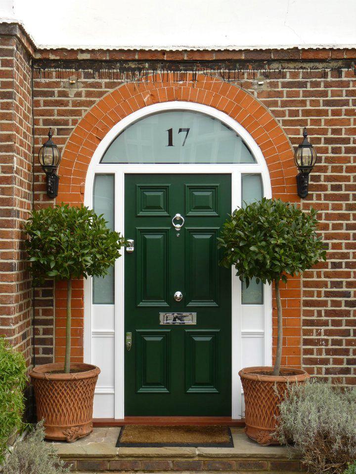 Lovely green door with nickel door furniture which can be ...