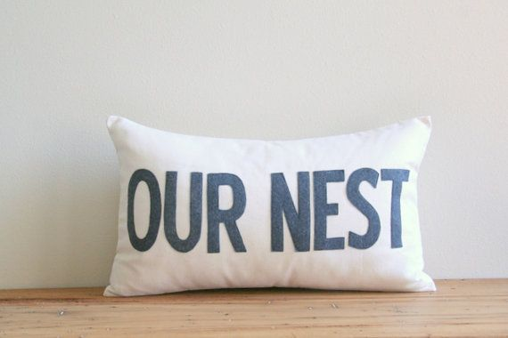 This beautiful pillow cover is made with natural cotton canvas fabric on the front and back with an added our nest in charcoal felted wool