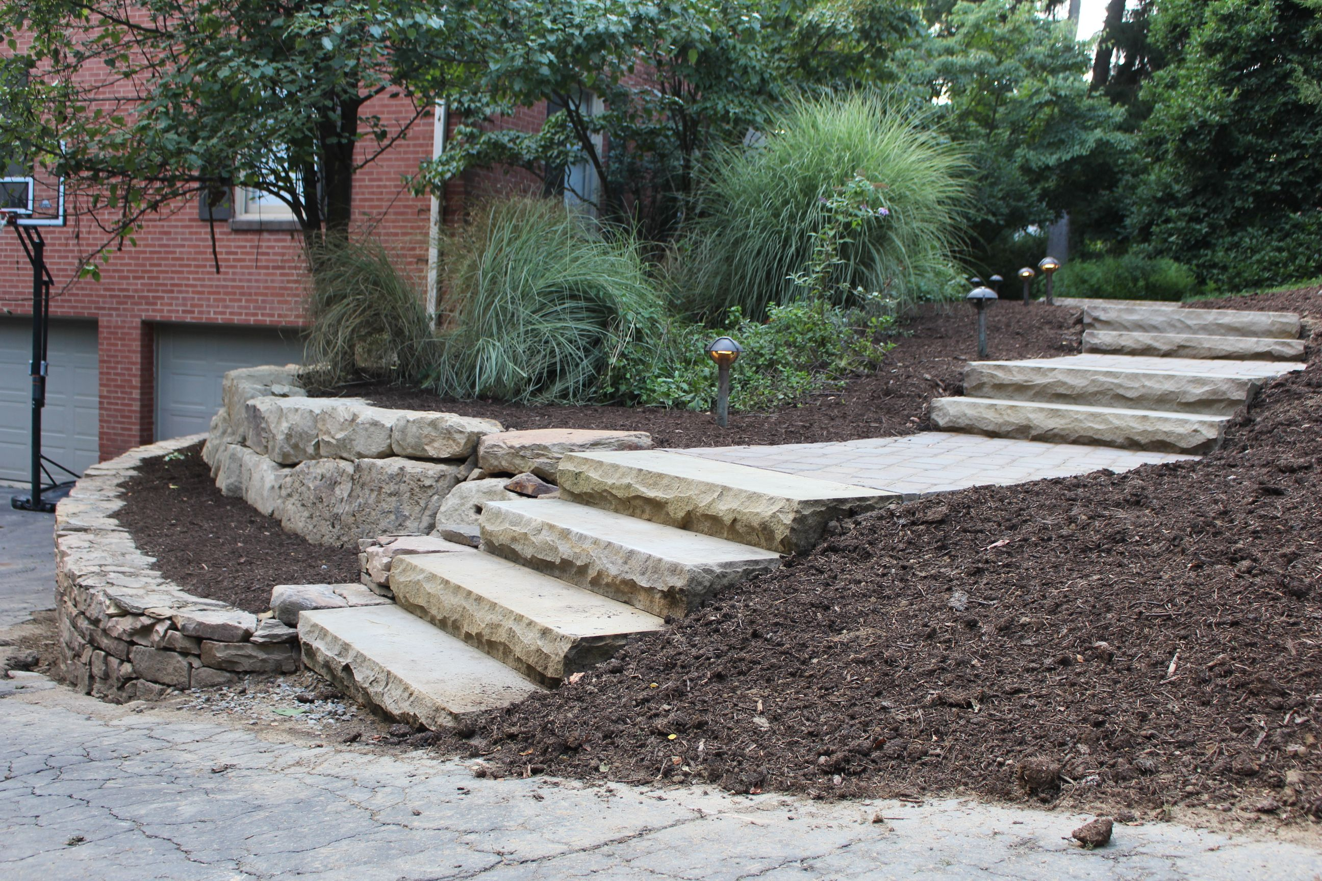 Sandstone Step Treads With A Double Tiered Natural Stone Retaining Wall