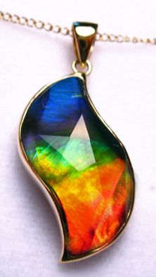 f2d4195f8baf9b ammolite jewelry www.canadianammolite.com # 25 GP - 18K Gold 20 x 11 mm  $799.99