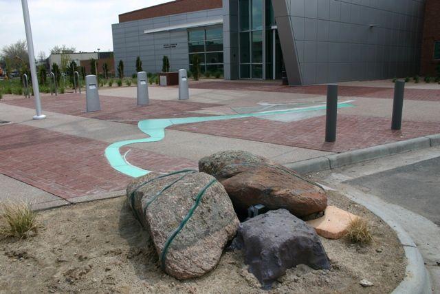 Arts and Venue Denver | Public Art | Denver Public Art Collection | Channeled Energy Flow  Caspar Henselmann  Stone, cast resin, steel, fiber optic light  District Two Police Station