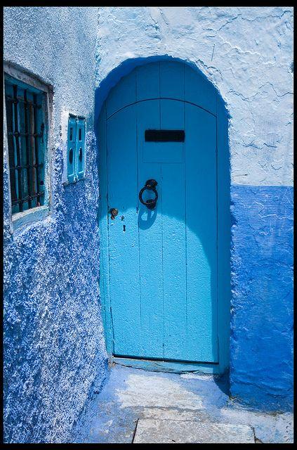 blue door in the corner