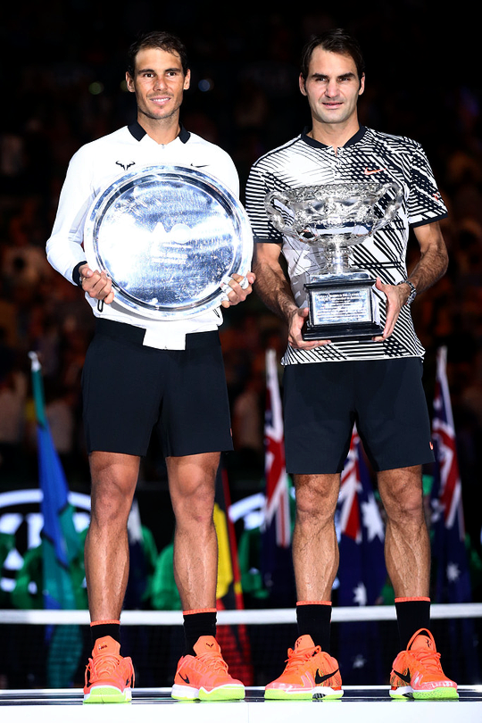 Rafael Nadal of Spain and Roger Federer of Switzerland pose after the Men's Final match on day 14 of the 2017 Australian Open at Melbourne Park on January 29, 2017 in Melbourne, Australia.