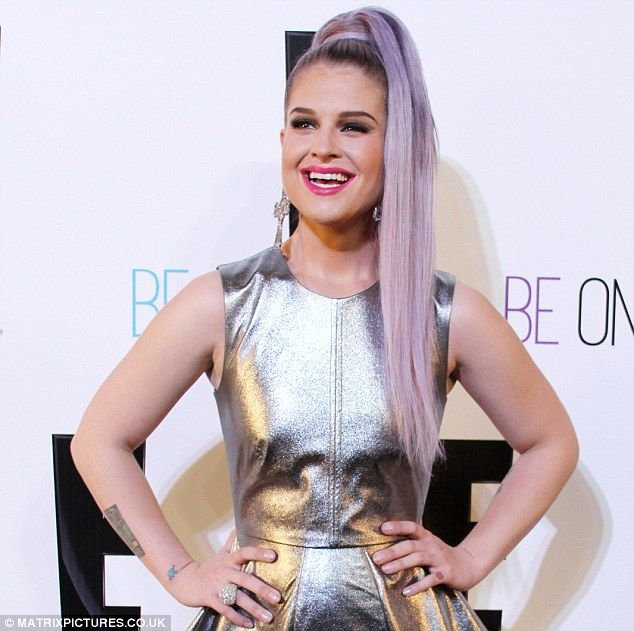 Kelly Osbourne invests in extensions to don long purple ponytail | Mail Online