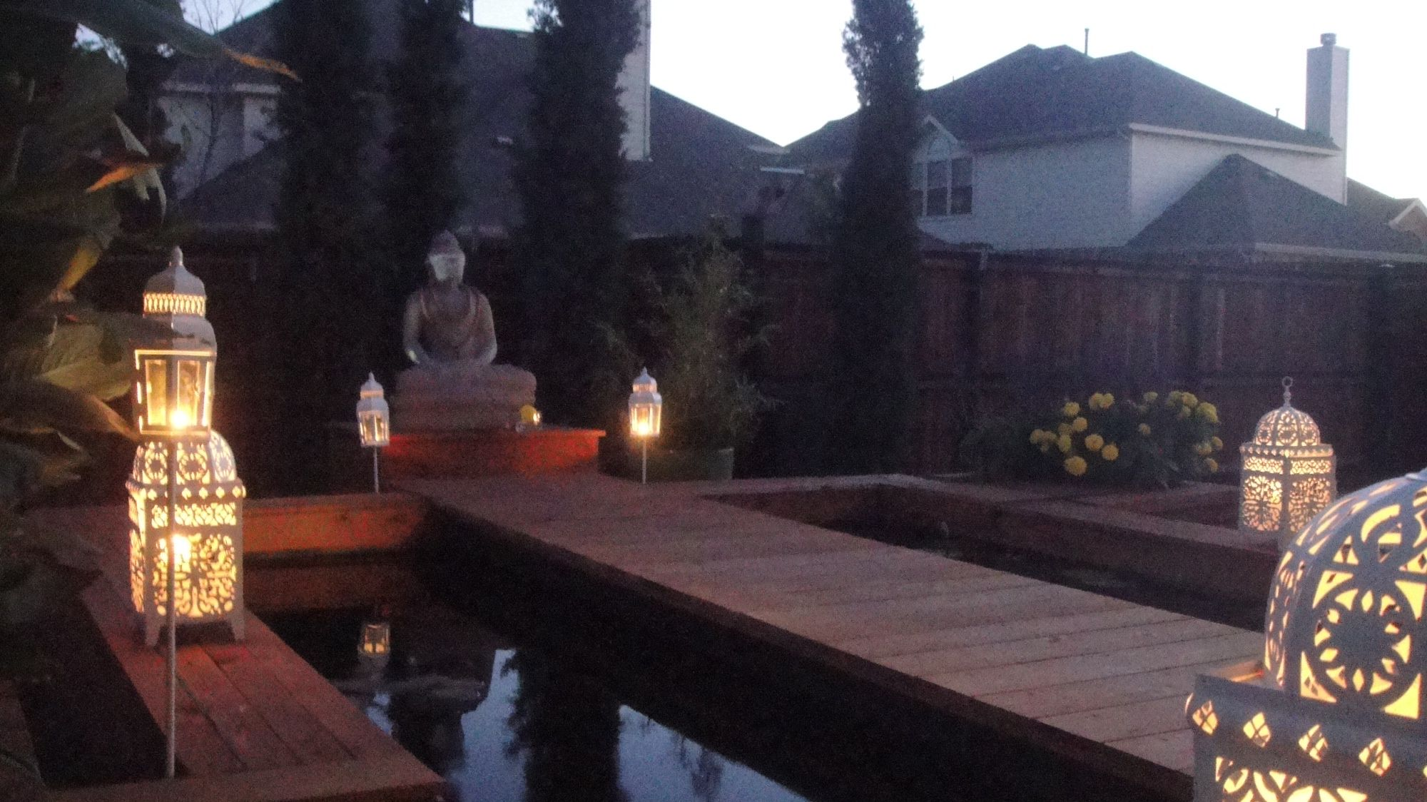 A contemporary Asian inspired koi pond with Buddha statue
