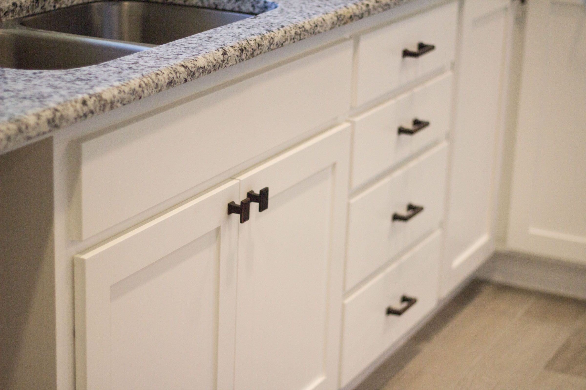 A Detail Shot Of The Slick White Shaker Style Cabinets Quartz Counter Tops And Stainless Steel Appliances Kit Shaker Style Cabinets Kitchen Kitchen Remodel