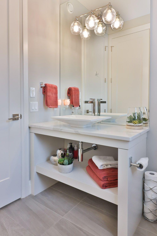 Transitional bathroom lighting fixture with open shelf vanity ...