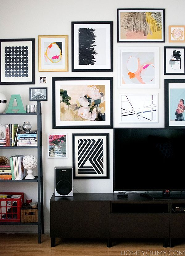 Navy Geo looks greatnestled among other beautiful prints in Homey Oh My's living room. Read more about how she assembled this terrific gallery wall here:http://bit.ly/1y27Z1l
