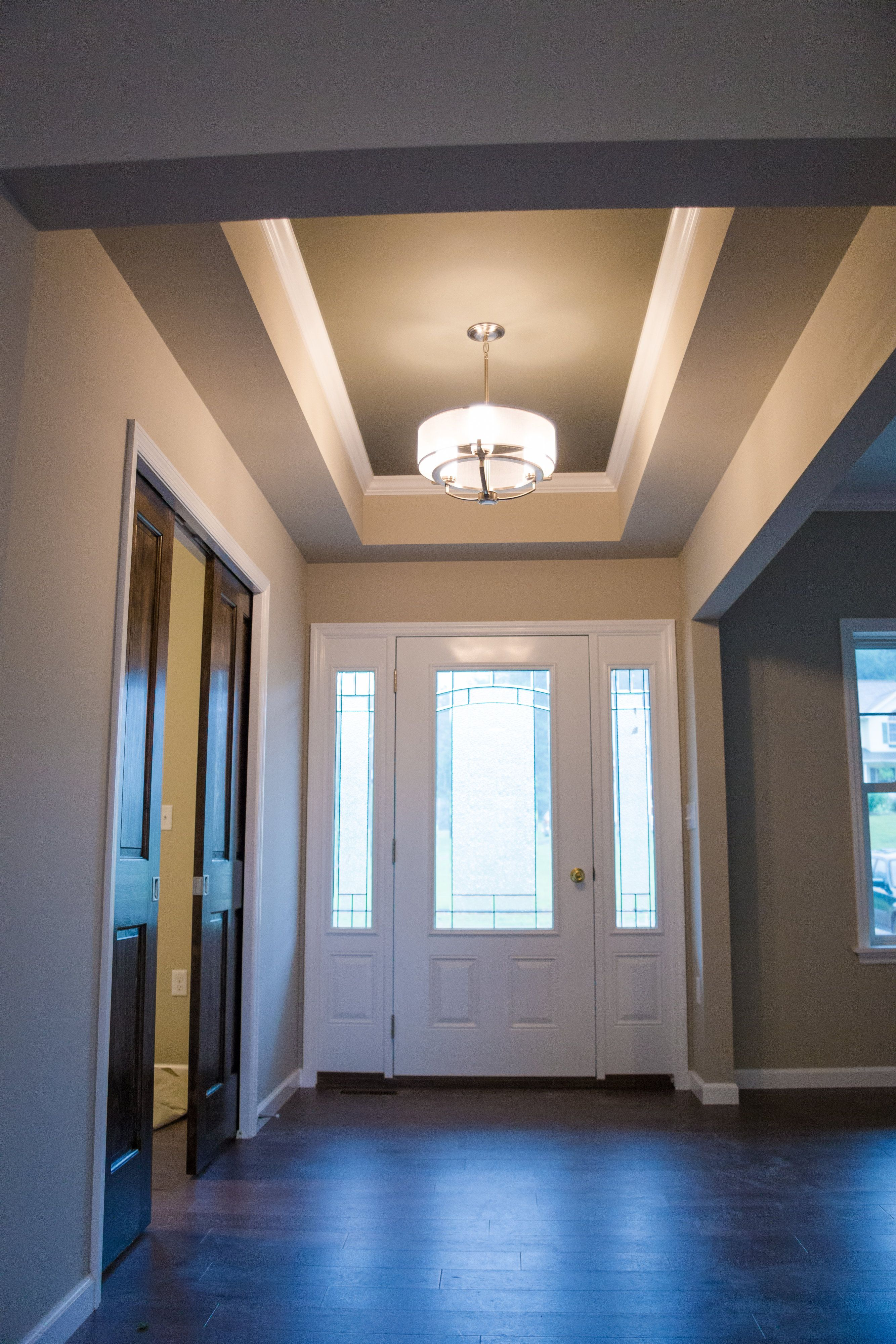 Front Entry Way And Foyer With Modern Light Fixture And Tray