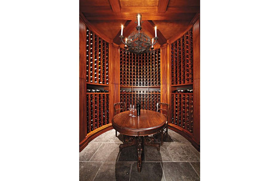 This Curved Wine Room Continues The Paneled Feel Felt