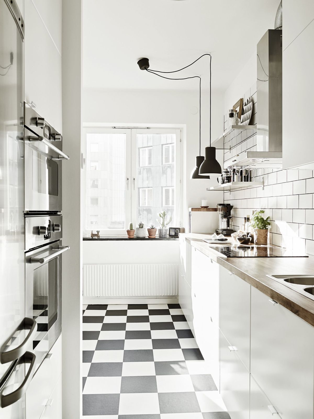 Should We Do Black White Checkerboard Floors In Our Basement White Tile Kitchen Floor White Kitchen Floor Kitchen Flooring