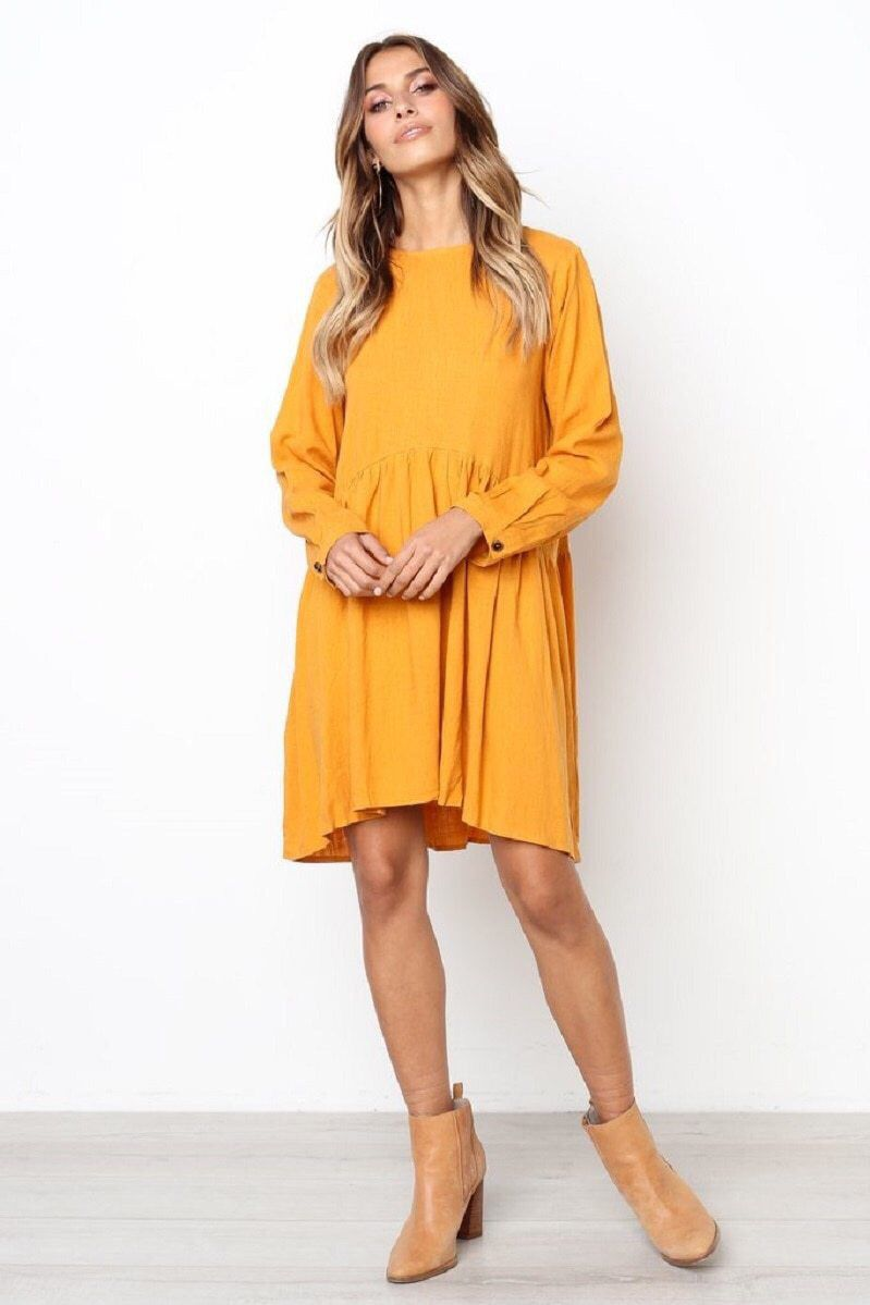 fb86eb55a8ef Knee length loose bright yellow dress with a big pleated hemlines for women  to the beach this summer. Cozy